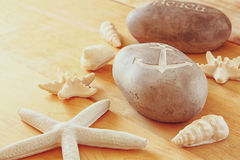 Close up of collection of nautical and beach objects over wooden background Royalty Free Stock Photo