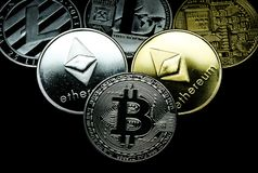 Close up of a collection of silver and gold crypto coins stock photo