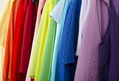 Close up on color coordinated clothes on hangers in a store. Royalty Free Stock Photo
