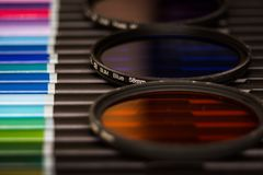Close-up of color filters. On a base of pencils of different colors stock images