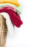 Close up color mix towel in wicker baskets on white background. Close up color mix the towel in wicker baskets on white background royalty free stock images