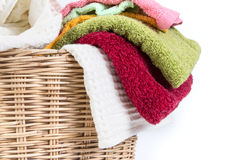 Close up color mix towel in wicker baskets on white background. Close up color mix the towel in wicker baskets on white background stock images