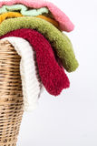 Close up color mix towel in wicker baskets on white background. Close up color mix the towel in wicker baskets on white background royalty free stock image