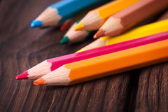 Close up of color pencils  on brown background Royalty Free Stock Image