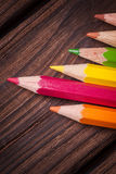 Close up of color pencils  on brown background Royalty Free Stock Images