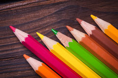 Close up of color pencils  on brown background Royalty Free Stock Photography