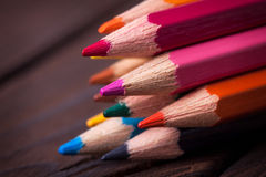 Close up of color pencils  on brown background Stock Photos