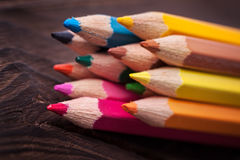 Close up of color pencils  on brown background Stock Images