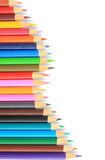 Close up of color pencils with different color over white backgr Royalty Free Stock Images