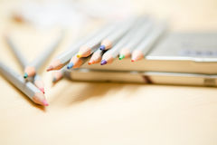 Close up of color pencils over wooden background Royalty Free Stock Photo