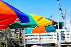 Close up of Colored Beach Umbrellas in a Sunny Day. On Blur Background. Destin Marina, Florida royalty free stock photos