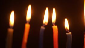 Close-up of colored candles burning fuse stock footage