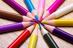 Close up of colored drawing pencils on wooden table Royalty Free Stock Photos