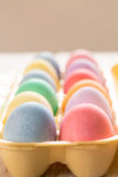 Close up of Colored Easter Eggs in Carton. Close up of colored Easter eggs in egg carton Stock Images