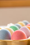 Close up of Colored Easter Eggs in Carton. Close up of colored Easter eggs in egg carton Stock Image