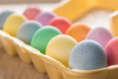 Close up of Colored Easter Eggs in Carton. Close up of colored Easter eggs in egg carton Stock Photography