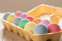 Close up of Colored Easter Eggs in Carton Stock Images