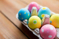Close up of colored easter eggs in egg box Stock Photography