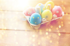 Close up of colored easter eggs in egg box Royalty Free Stock Photos