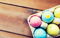 Close up of colored easter eggs in egg box Royalty Free Stock Photo