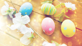 Close up of colored easter eggs and flowers Stock Photography