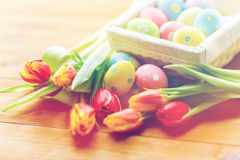 Close up of colored easter eggs and flowers Stock Image