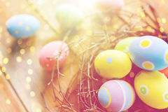 Close up of colored easter eggs in nest on wood Royalty Free Stock Photography