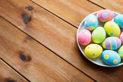 Close up of colored easter eggs on plate stock photos