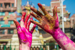 Close-up of colored hands during Holi Festival Royalty Free Stock Photo