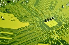 Close up of colored micro circuit board. Abstract technology background. Computer mechanism in detail. S stock image