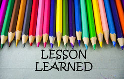 Close up colored pencil writing with LESSON LEARNED.Education concept Stock Photo