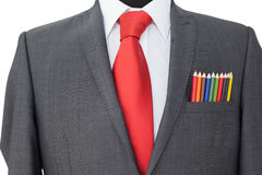 Close-up of colored pencils in coat pocket Stock Photo
