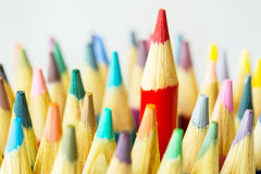 Close Up Colored Pencils With Red One Sticking Up Higher Stock Image
