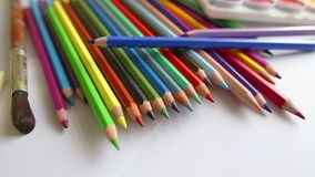 Close-up colored pencils and watercolor stock footage