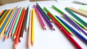 Close-up colored pencils and watercolor stock video footage