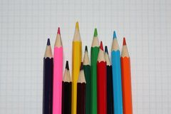 Close-Up Of Colored Pencils On white Paper royalty free stock photography