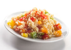 Close up of colored quinoa salad with vegetables Stock Images