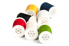 Close up of colored thread bobbins. On white background Royalty Free Stock Image