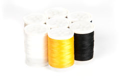 Close up of colored thread bobbins. On white background Stock Image