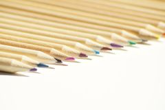 Close up on colored wooden pencils royalty free stock photos