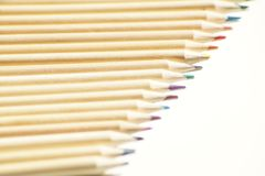 Close up on colored wooden pencils royalty free stock image