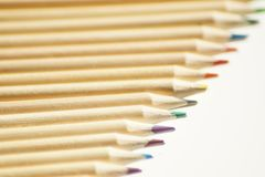 Close up on colored wooden pencils royalty free stock photo