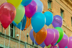 Close up of colorful baloon in front of an office building. In little city royalty free stock photography