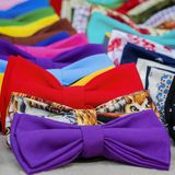 Close-up of colorful bow ties for hipsters, creative subculture. Vivid picturesque backdrop for square wallpaper, design. Close-up of colorful bow ties for Stock Photo