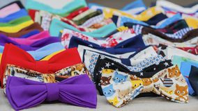 Close-up of colorful bow ties for hipsters, creative subculture. Vivid picturesque backdrop for wallpaper, design. Web, banner, poster, selective focus Stock Images