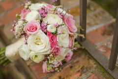 Close up of a colorful bridal bouquet on bricks Royalty Free Stock Photos