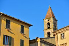 Close-up of colorful buildings, bell tower and rooftops in a blu. E sunny day at Umbertide, a gracious little town near Perugia, Italy royalty free stock photo