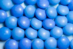 Close up a colorful candies of chocolates. With blue colors Stock Photos
