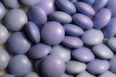 Close up a colorful candies of chocolates. With purple colors Stock Photo