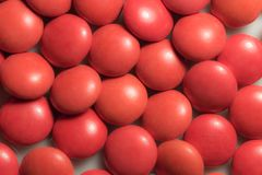 Close up a colorful candies of chocolates. With red colors Royalty Free Stock Image